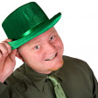 图库照片: Leprechaun: Cheerful Irish MIn Green