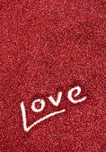 Glitter: Love Written in Red Glitter Background — Stock Photo