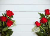 Valentine's: Red Roses on White Wood Background — Stock Photo
