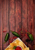 Background: Chips and Salsa with Jalepenos — Stock fotografie