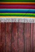 Background: Mexican Blanket with Wooden Table Copyspace — Stockfoto