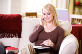 At Home: Woman Setting Up Date With Friend — Stock Photo
