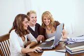 Students: Laughing At Something Online — Stock Photo