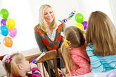 Birthday: Little Girl Blows Party Horn — Stock Photo