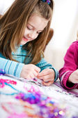 Birthday: Cute Girl Doing Birthday Craft — Stockfoto