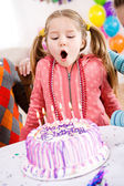 Birthday: Girl Makes Birthday Wish And Blows — Stock Photo
