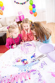 Birthday: Friend Blows Out Birthday Cake Candles — Stock Photo