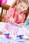 Birthday: Girl Takes a Sneak Taste Of Frosting — Stock Photo