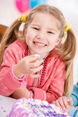Birthday: Smiling Girl Steals Taste Of Birthday Cake — Stock Photo