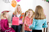 Birthday: Cute Girl Gets Present At Party From Friend — Zdjęcie stockowe