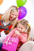 Birthday: Girl Gets Present From Mother — Stock Photo