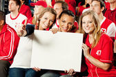 Fans: Friends Hold Up Blank Sign — Stock Photo