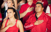 Fans: Crowd Stands For National Anthem — Stock Photo