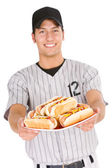 Baseball: Player Holding Plate of Hot Dogs — Photo