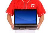 Baseball: Player Holds Up Laptop With Blank Screen — Stok fotoğraf