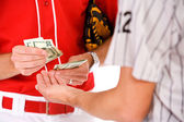 Baseball: Players Exchanging Money In Bet Or Bribe — Zdjęcie stockowe