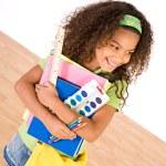 Student: Girl Student Holding School Supplies — Stock Photo #50428501