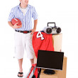 Student: Guy Holding Football With Stack Of Dorm Room Stuff — Stock Photo