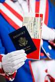 Patriotic: Holding A Passport And Airline Ticket — Stock Photo