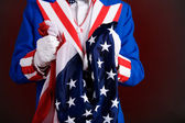 Patriotic: Holding An American Flag — Stock Photo