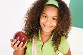 Student: Student Girl Holding an Apple — Stock fotografie