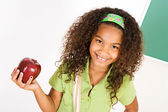 Student: Student Girl Holding an Apple — Foto Stock