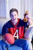 Football: Having A Beer And Watching Game On TV — Stock fotografie