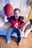Football: Fan On Couch Cheers For Team — Photo