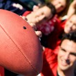 Tailgating: Man Holds Football Out To Camera — Stock Photo #51023099