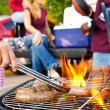 Tailgating: Bratwurst or Sausage On The Grill At Tailgate Party — Stock Photo #51023611