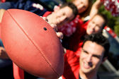 Tailgating: Man Holds Football Out To Camera — Foto Stock