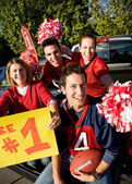 Tailgating: Excited Fans Cheering For Team And Holding Sign — Photo