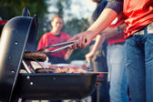 Tailgating: Man Grilling Sausages And Other Food For Tailgate Pa — Foto Stock