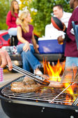 Tailgating: Bratwurst or Sausage On The Grill At Tailgate Party — Stock Photo