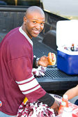 Tailgating: Hungry Football Fan Gets Snack From Table — Foto Stock