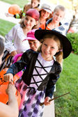 Halloween: Children Lined Up for Halloween Candy — Stock Photo