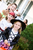 Halloween: Children In A Line Going To Next House — Стоковое фото