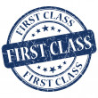 First class blue grunge stamp — Stock Photo