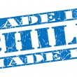 图库照片: Made in Chile grunge blue stamp