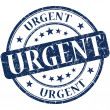 Urgent grunge round blue stamp — Stock Photo