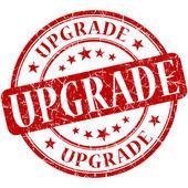 Upgrade grunge round red stamp — Stockfoto