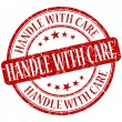 Handle with care grunge red round stamp — Stock Photo