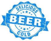 Delicious cold beer blue grunge vintage seal — Stock Photo