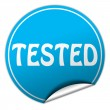 Stock Photo: Tested round blue sticker on white background