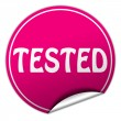 Stock Photo: Tested round pink sticker on white background