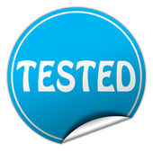 Tested round blue sticker on white background — Stock Photo