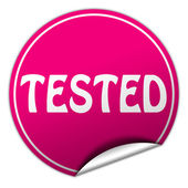 Tested round pink sticker on white background — Stock Photo