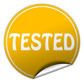 Tested round yellow sticker on white background — Stock Photo