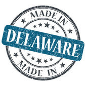 Made in Delaware blue round grunge isolated stamp — Stock Photo