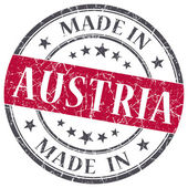 Made in Austria red grunge round stamp isolated on white background — Stock Photo